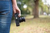 Female photographer, Camera on hand. Photograph hobby