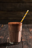 Chocolate Milkshakes on Wooden Background