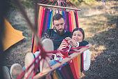 Romantic hipster couple enjoy rest on a hammock