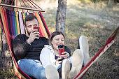 Beautiful happy couple relaxing in a hammock