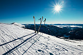 Skis are in deep snow on the ski track in sunny bright light