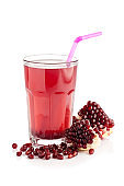 Pomegranate juice glass isolated on white background