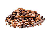Chocolate bars and candies heap on white background