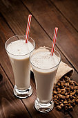 Two glasses of refreshing Horchata de Chufa drink shot on rustic wooden table