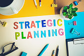 STRATEGIC PLANNING word on desk office background