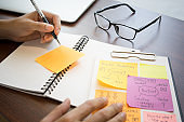Businessman working with note paper for brainstorming marketing ideas.