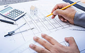 Architect working with plan design.Concepts idea of architecture,construction,engineering.