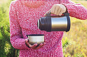 man with thermos in park