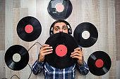 man with vinyl records
