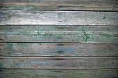 wooden boards with green and blue traces of paint