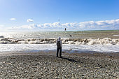 man standing alone and watching on the Black sea