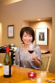 Woman drinking wine at the BAR counter