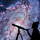 Girl looking at the stars with telescope. Messier 83, Southern Pinwheel Galaxy, M83 in the constellation Hydra.