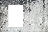 Close-up empty blank canvas on background concrete wall