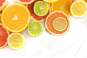 Grapefruit, lime, lemon, and orange slices with copyspace