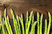 Green asparagus stalks, overhead photo with copy space