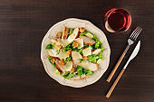 Chicken Caesar salad and wine with copy space