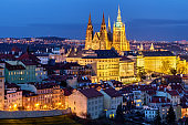 Prague Castle complex with gothic St Vitus Cathedral, Hradcany, Prague, Czech Republic. UNESCO World Heritage. Panoramic aerial shot from Petrin Hill.