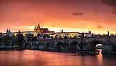 Fantastic natural phenomena summer storm over Charles bridge, Prague castle and Vltava river in Prague, Czech Republic