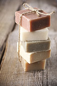 Assorted natural soap bars on wood