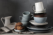 Crockery and cookies on kitchen table