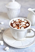 Hot chocolate with mini marshmellow in a white vintage cup