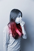 Woman coughing with mask