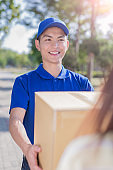 deliveryman stand and smile