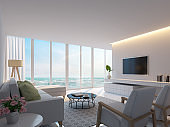 Modern white living room with sea view 3d rendering image