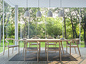 Modern dining room in the glass house 3d render image