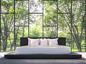 Modern bedroom with garden view 3d rendering Image