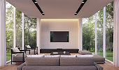 Modern living room with garden view 3d rendering Image
