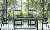 Modern dining room with garden view 3d rendering Image