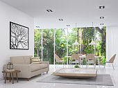 Modern white living and dining room with nature view 3d render image