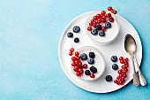 Chia seed pudding, cheesecake, custard dessert with fresh berries. Copy space. Top view