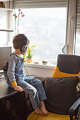 Boy listening to music wearing headphones