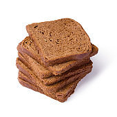 Pile Brown bread toast isolated over white. Low-calorie grain bread.