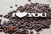 Coffee beans are scattered on the table, the words 'I love you'