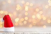 Christmas decor with santa hat. Vintages background.