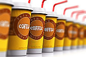 Row of plastic or paper coffee cups with straws