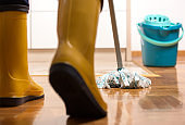 Maid mopping floor