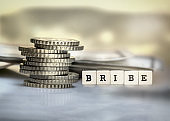 Bribe concept with coins and banknotes.