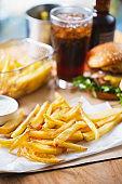 crispy french fries pile with hamburger