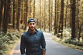 solo traveler walking in the hoh rainforest