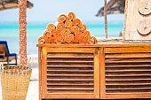Orange beach towels near outdoor pool in luxury resort