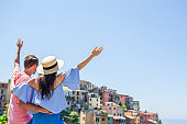 Happy family with view of the old european village in Cinque Terre national park, Liguria, Italy ,Europe
