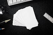 Blank business card mock up on table for design business contact