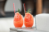 refreshing orange coctail with grapefruit isolated on a table