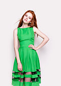 Beautiful redhead woman in lovely green dress
