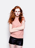 Young beautiful redhead woman wearing stylish clothes Fashion model portrait
